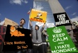 Protestors chant and holds signs outside the the Federal Reserve Bank of Dallas building in downtown Dallas, Thursday, Oct. 6, 2011.  Protestors across the state marched against the current state of the economy and corporate influence on the government.  (AP Photo/LM Otero)